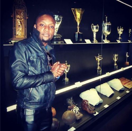 Singer KCee Takes A Tour Of Santiago Bernabeu Strikes Pose With